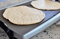 flatbread made as round as the pan and as flat as you can